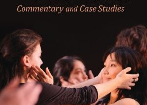 """""""Performance and Community: Commentary and Case Studies"""" edited by Caoimhe McAvinchey. Cover art is two women in blacks reaching out and touching each others face."""