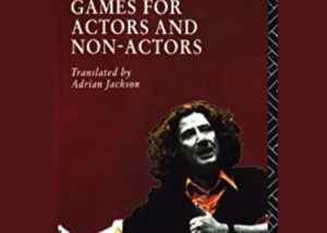 """""""Games for actors and non-actors"""" by Augusto Boal, translated by Adrian Jackson. Cover art is of a young Boal gesticulating one arm out to the side and one across his chest, both hands have thumbs up. He is wearing a red shirt and black jumper and has a thick bush of long red hair."""