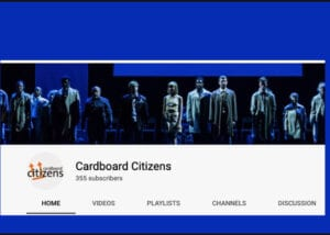 Cardboard Citizens Youtube Page, cover photo is an ensemble of performers looking downstage against a blue and black backdrop