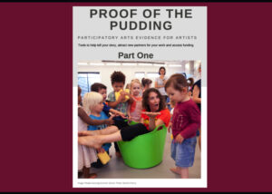 Proof of the pudding part one. Cover art is a group of toddlers gathered around a woman who is feigning shock at the fact that she is sat in a green bucket.