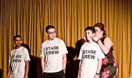 3 Stage crew members on stage