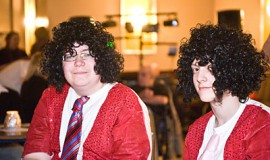 Two boys in curly wigs
