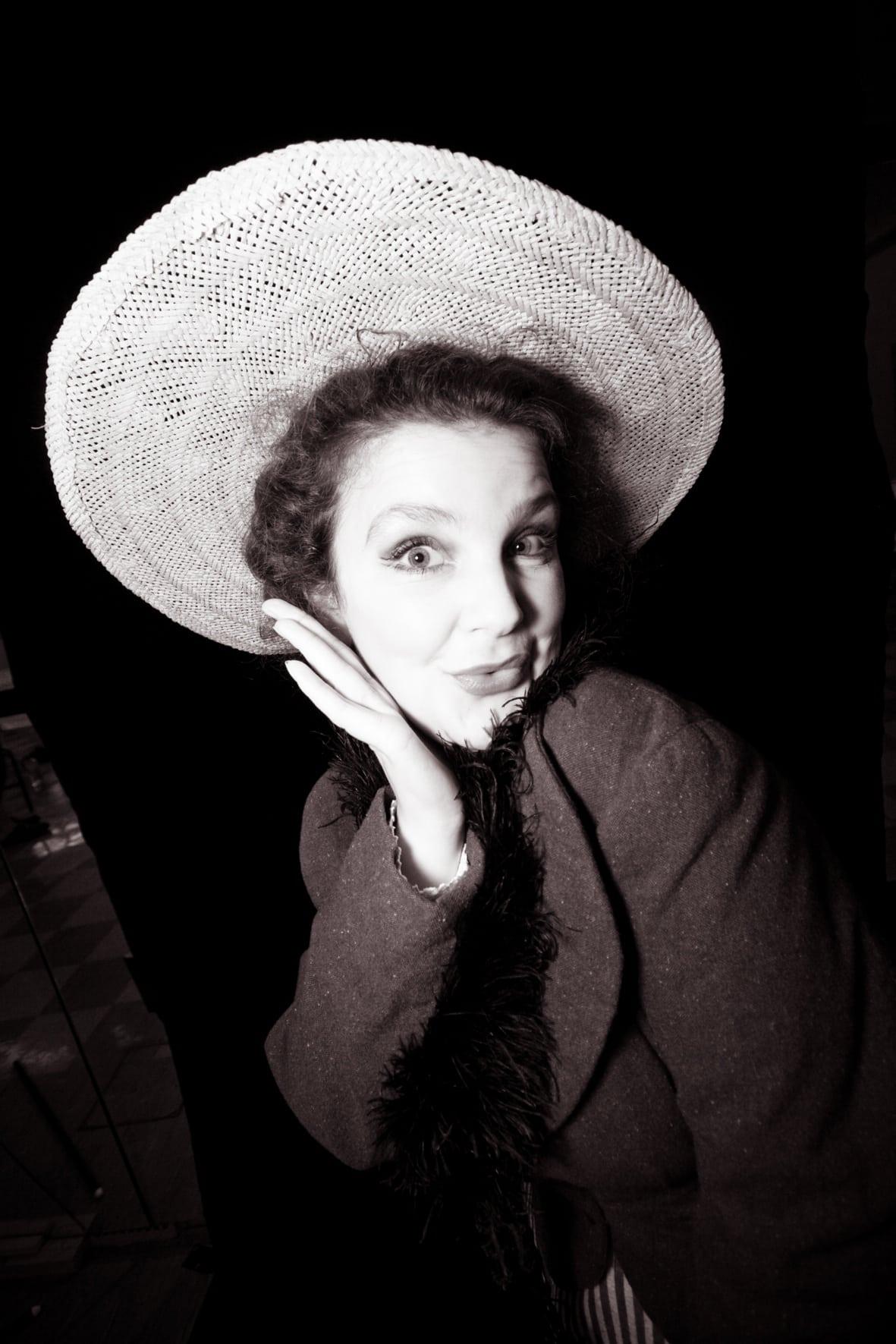 Lady posing wearing hat